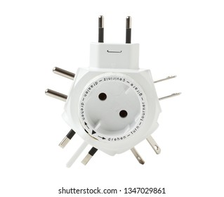 "Travel plug adapter isolated on white background with text ""turn"" in seven languages"