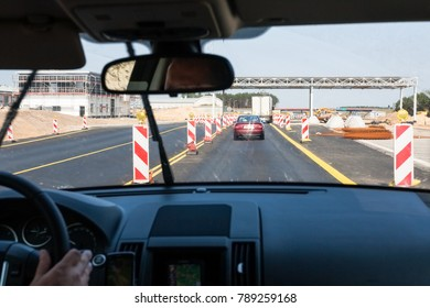 travel to Poland - driving car along repairing area on Autostrada Wolnosci (Motorway of Freedom) A2 (a part of the European route E30 connecting Berlin and Moscow) in summer day