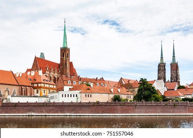 travel to Poland - towers of Collegiate Church of the Holy Cross and St Bartholomew and Cathedral of St John the Baptist in Ostrow Tumski district in Wroclaw city from Oder River