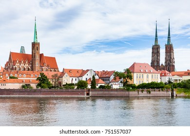 travel to Poland - view of Ostrow Tumski district in Wroclaw city with Collegiate Church of the Holy Cross and St Bartholomew, Cathedral of St John the Baptist, Archbishop's, palace from Oder River