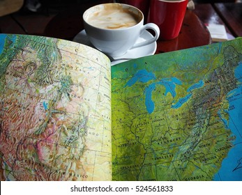 Travel preparation -a map of the world and coffee