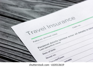 Travel preparation concept with insurance on wooden table