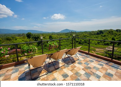 Travel relax. The balcony of the resort. View of the field on the Moutain Natural Touch countryside