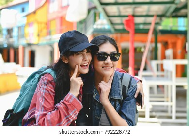 Travel and relaxing Concepts, Tourists are taking photos in the city. Asian girls are happily traveling. Beautiful girl is relaxing Travel