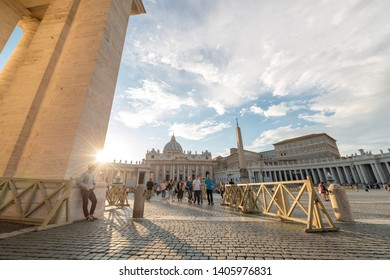Travel to Rome, Italy - 10.2018. People on Piazza San Pietro (St Peter Square) and view of St Peter Basilica in Vatican city in sunny autumn day. World's largest church - Papal Basilica of St. Peter.