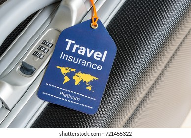 Travel safety and travel insurance concept : Travel insurance tag is hung near a numeric combination lock. Travel insurance is intended to cover lost luggage, trip cancellation, accident, losses, etc