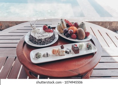Travel series. beautiful breakfast dessert and tropical fruits on table with ocean view