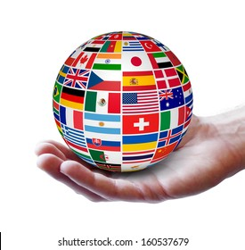 Travel, services and international business concept with a globe and international flags of the world on a man hand. Isolated on white background.