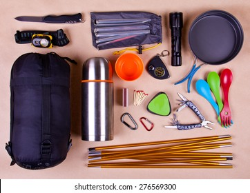 Travel set. Tourist outfit for camping or hiking. Various professional tools and items for outdoors pastime on beige background.