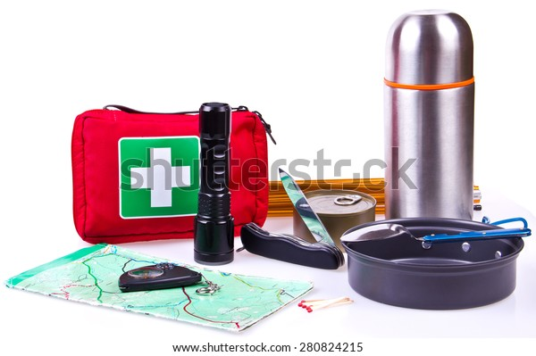 Travel set. Tourist outfit for camping or hiking. Various professional tools and items for outdoors pastime on white background, partly isolated with shadows. Place for your text.