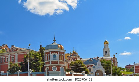 Travel showplace - Iversky Women's Monastery in Samara in sunny summer day, blue sky. Classic russian ortodox religion architecture