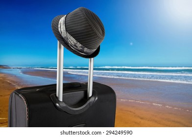 travel suitcase on the beach