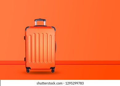 Travel suitcase on orange background