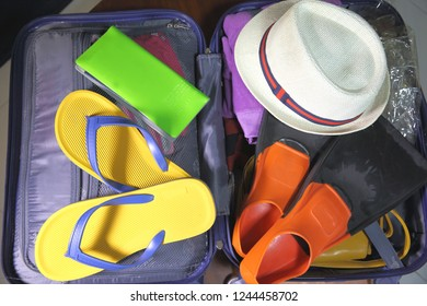 Travel suitcase. Open suitcase packed for travelling