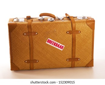 a travel suitcase with a text fragile