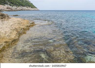 Travel summer, Mediterranean sea crashing against the rocks of the Spanish island of Mallorca, Ibiza, Spain.