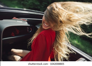 Travel and summer vacation. Sexy woman drive car, fashion, beauty. Businesswoman or pretty woman in convertible car. Modern life, luxury, city, glamour. Business trip or commanding, happy girl driver.