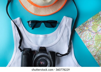 Travel, summer vacation and tourism concept. Map, camera, straw hat, sunglasses and outfit tourist.