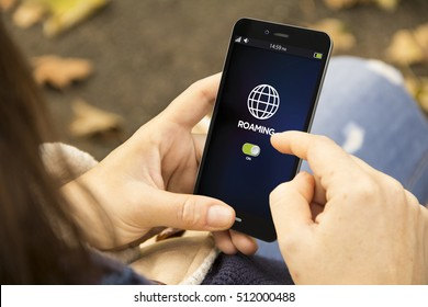 travel and technology concept: woman holding a 3d generated smartphone with roaming on the screen. Graphics on screen are made up.