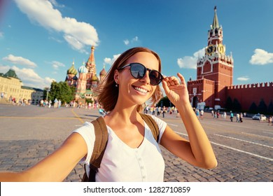 Travel and techology. Happy young woman taking selfie on Red Square in Moscow, Russia.