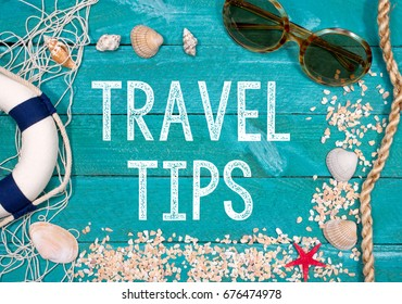 Travel Tips - beach utensils with text on wooden background - recommendation for summer holidays or vacation