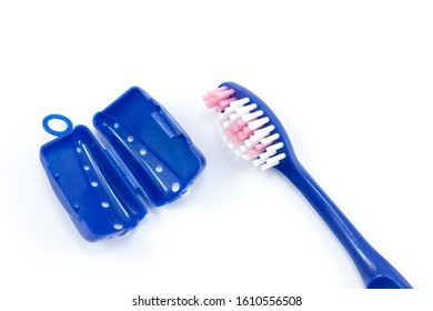 Travel toothbrush with protective cap on a white background