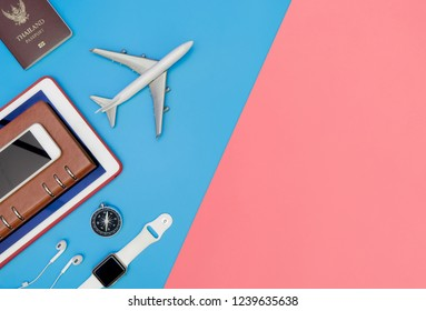 Travel top view accessories objects for traveler on blue and pink