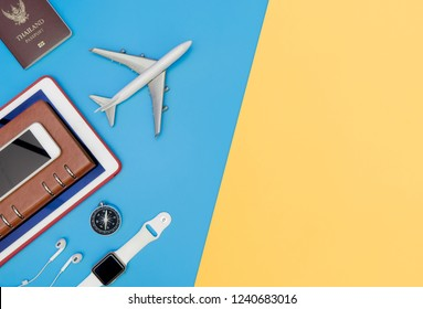 Travel top view gadgets and objects for business traveler on blue yellow copy space