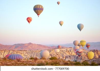 Travel and tourism by Turkey. Famous sightseeing Cappadocia, Anatolia. Beautiful landscape with mountains, caves and baloons in the sky.