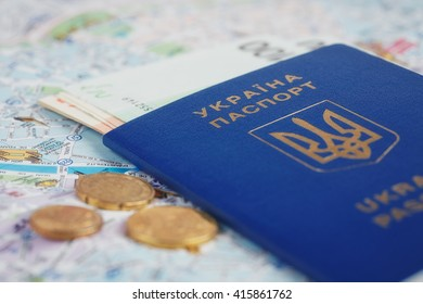 Travel and tourism concept: ukrainian passport and money on map