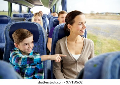 travel, tourism, family, technology and people concept - happy mother and son riding in travel bus