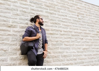 travel, tourism, lifestyle and people concept - man with backpack standing at city street wall