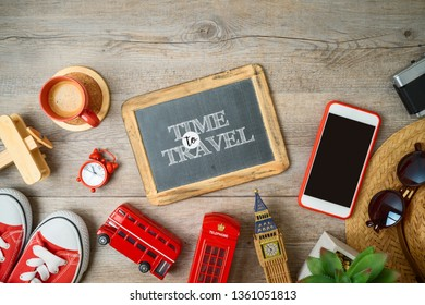 Travel and tourism to London, Great Britain background with chalkboard and souvenirs on wooden table. Top view from above