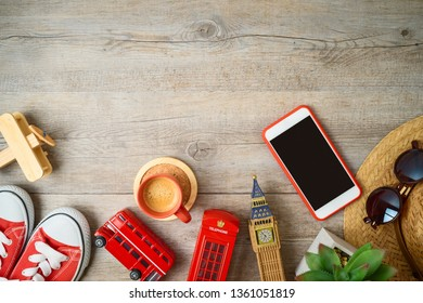 Travel and tourism to London, Great Britain background with souvenirs on wooden table. Top view from above