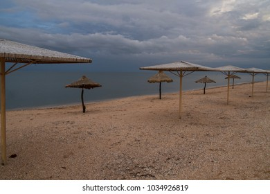 Travel and tourism on the shore of ocean and sea. umbrellas stand along the beach near the water