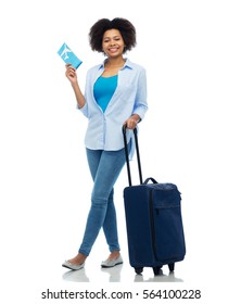 travel, tourism and people concept - smiling young woman with airplane ticket and bag