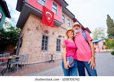 Travel and tourism. Senior family couple walking together on Turkey's street.