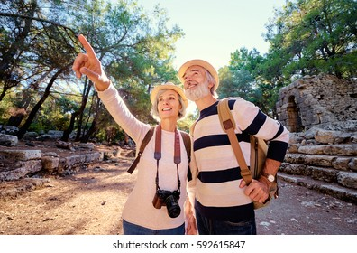 Travel and tourism. Senior family couple walking together on ancient sightseeing.