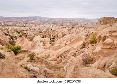 Travel and tourism in Turkey. Famous sightseeing Cappadocia, Anatolia. Beautiful landscape with mountains, caves and cloudy sky.