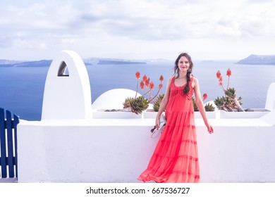 Travel Tourist Happy Woman Santorini, Greek Islands, Greece, Europe. Girl on summer vacation visiting famous tourist destination having fun smiling in Oia.