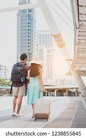 Travel tourist standing with luggage looking map in smartphone at the city. Travelers using gps map for sightseeing in town. Couple tourist walking with luggage and travel in city. Travel lifestyle.