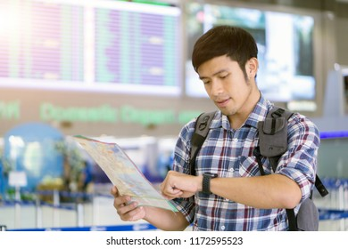 Travel tourist use map in smartphone at the city. Travelers looking gps map on watch for sightseeing in town. Travel lifestyle.