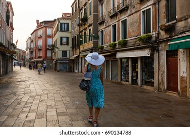 Travel tourist woman with backpack in Venice, Italy. girl on vacation smiling happy girl having fun traveling outdoors.