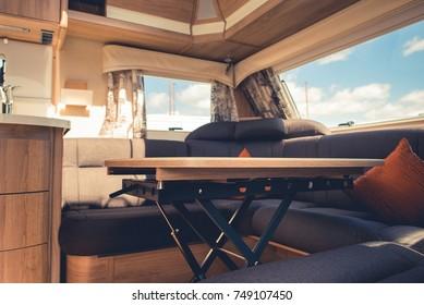 Travel Trailer RV Dining Area. Elegant Recreational Vehicle Interior.