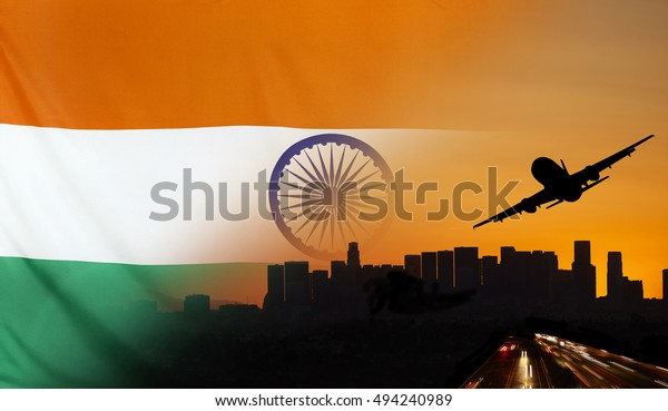 Travel and transport concept with skyline silhouette, highway traffic and airplane at sunset merged with real fabric flag of India