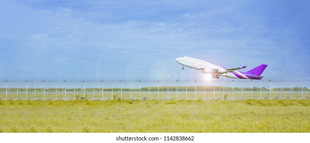 travel and transportation concept from aircraft fast run and take off from runway with blue sky and cloud background