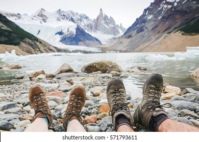 Travel trekking leisure holiday concept. Couple in hiking boots having fun and enjoying wonderful breathtaking mountain view