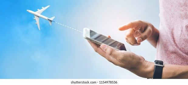 Travel trip concepts with male hand using smartphone,mobile and airplane on sky.Booking flight ticket content ideas