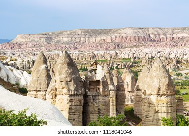Travel to Turkey - fairy chimney rocks in mountain valley of Goreme National Park in Cappadocia in spring