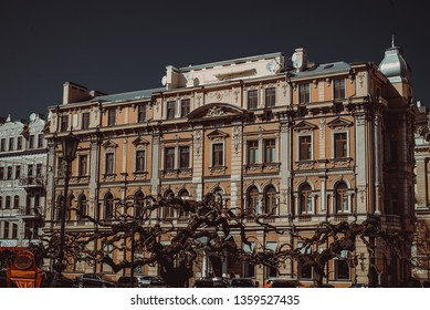 Travel to Ukraine. Odessa city. Building facade. Eastern Europe architecture. Tourism concept. Tourist attraction. City toure. Sophora japonica trees. Street view